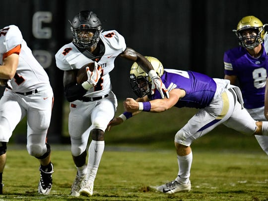 Ensworth's Keshawn Lawrence (4) rushes past CPA's Kane Patterson (4) during a game last season.
