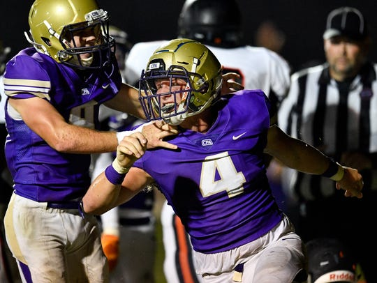 CPA's Kane Patterson (4) celebrates his touchdown against