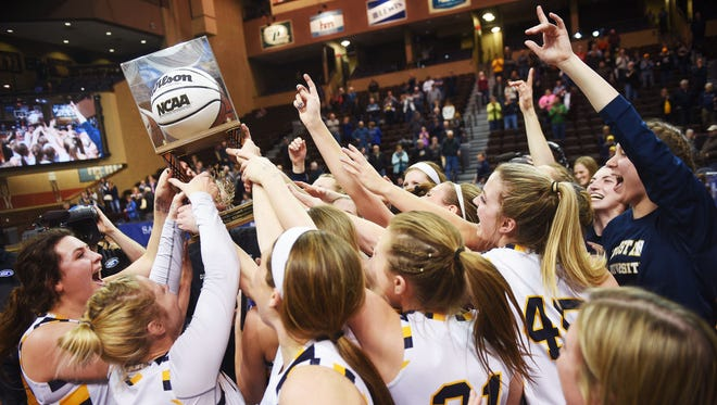 Augustana celebrates their win after the game against Winona State University in the NSIC championship game Tuesday, Feb. 27, at the Sanford Pentagon in Sioux Falls.