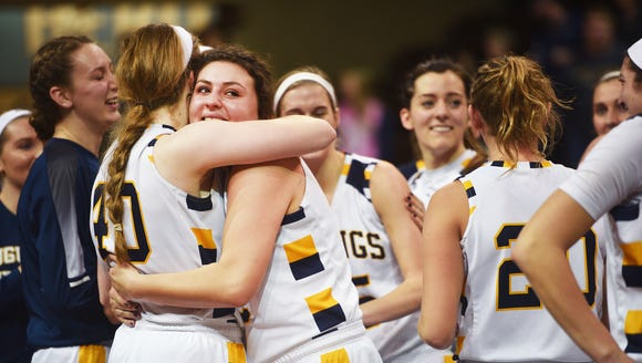 Augustana celebrates their win after the game against