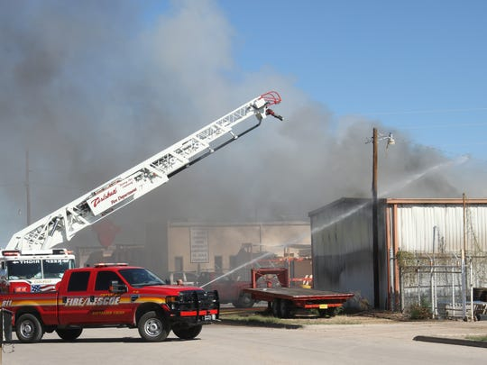 The Carlsbad Fire Department worked to put out a fire at a storage facility on South Main St. on Monday.