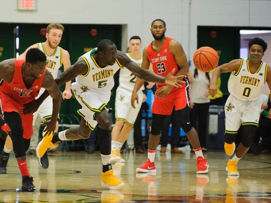 Vermont's Samuel Dingba (5) steals the ball from Stony Brook's Junior Saintel (11) during the men's basketball game between the Stony Brook Seawolves and the Vermont Catamounts at Patrick Gym on Saturday afternoon January 13, 2018 in Burlington.
