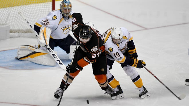 Anaheim Ducks left wing Nick Ritchie (37) and Nashville Predators center Calle Jarnkrok (19) battle for the puck in front of Nashville Predators goalie Pekka Rinne (35) during the second period of game 2 of the Western Conference finals at the Honda Center in Anaheim, Calif., Sunday, May 14, 2017.