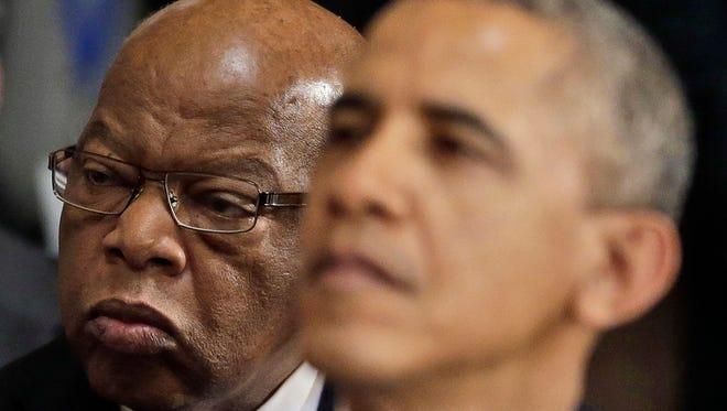 Rep. John Lewis, D-Ga., and President Obama in October.