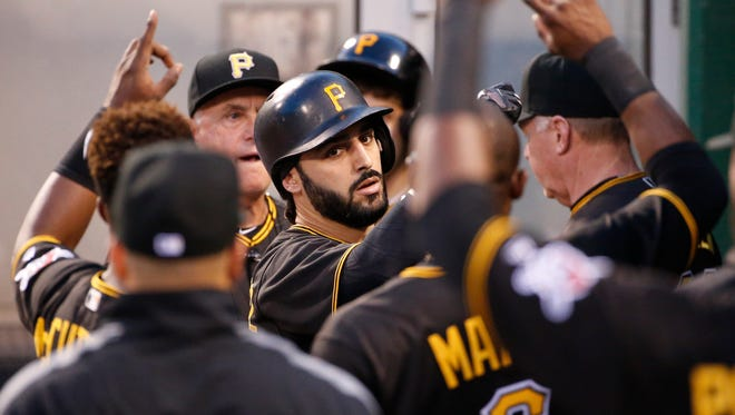 Pittsburgh Pirates' Sean Rodriguez, center, celebrates in the dugout after hitting a solo home run off Arizona Diamondbacks starting pitcher Rubby De La Rosa in the fourth inning of a baseball game in Pittsburgh, Wednesday, May 25, 2016.