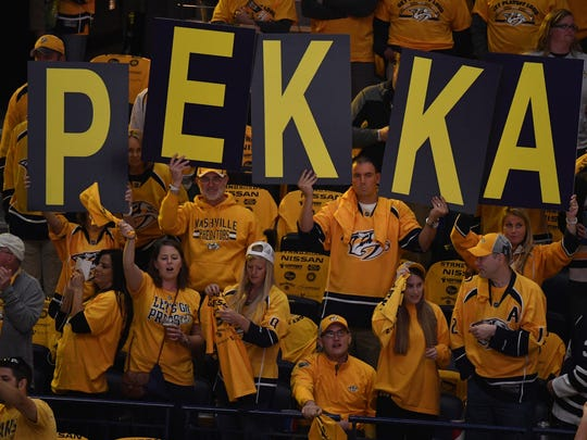 Fans of Nashville Predators goalie Pekka Rinne show their support before the start of Game 4 of the Stanley Cup Final at Bridgestone Arena in Nashville on Monday, June 5, 2017.