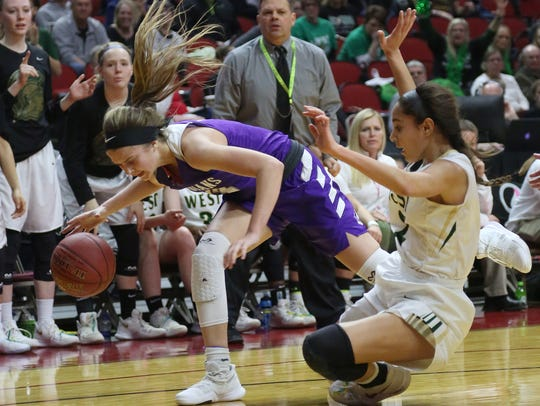 Indianola junior Maggie McGraw gets tangled up with