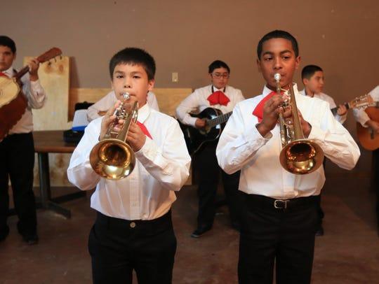 Jonathan Lara (left), 12, and Damien Perez, 12, members