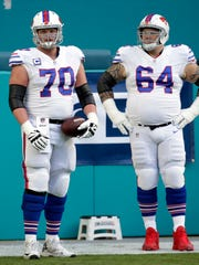 Buffalo Bills center Eric Wood (70) and offensive guard Richie Incognito (64), warm up before during the first half of an NFL football game against the Miami Dolphins.