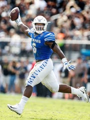Memphis defender Genard Avery celebrates grabbing a fumble against the UCF offense during second quarter action of the the AAC Championship football game in Orlando, Fl., Saturday, December 2, 2017.