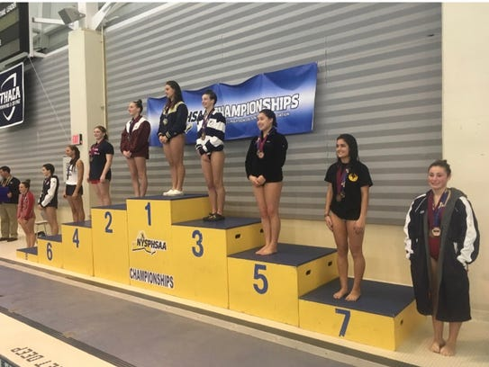 Scarsdale's Maddie Seltzer (6), Pelham's Jennifer Bell (4) and Scarsdale's Samantha Ho (5) were all on the podium at Friday's NYSPHSAA diving championships at Ithaca College.