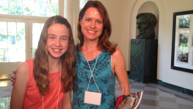 Sarah Ganser and her mother, Jennifer, arrive at the White House for Friday's event.