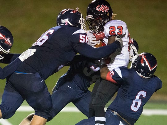 South-Doyle defenders, from left, Tyler Johnson, Wesley
