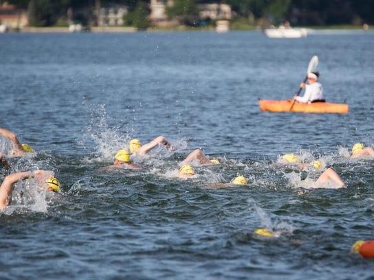 Swimmers line up at Willard Beach to start the 2015