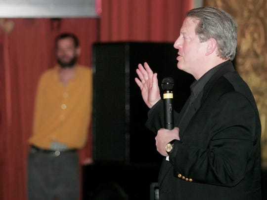 "Former Vice President Al Gore talks to the audience at Belcourt Theatre during a Q&A session after a private screening of his documentary ""An Inconvenient Truth"" in 2004."