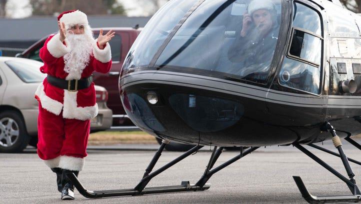 Reindeers take a break as Santa arrives in helicopter