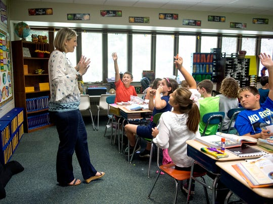Angie Wright leads a social studies lesson about Marco Polo with her Fifth grade class at Sharon Elementary School in Newburgh.