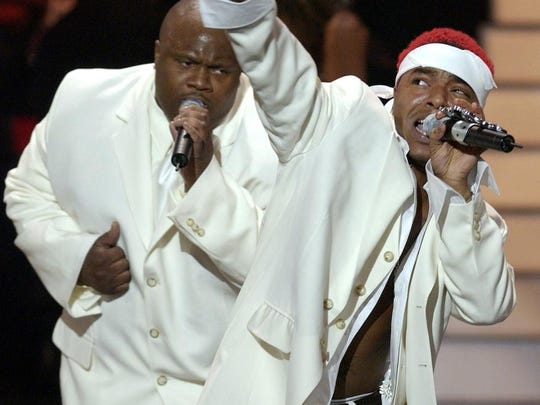 Sisqo, right, of the rap act Dru Hill, performs with his group at the 17th Annual Soul Train Music Awards in 2003