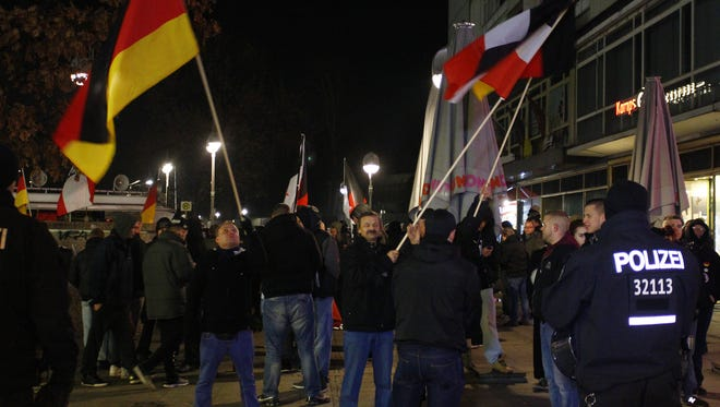 Supporters of Germany's far-right National Democratic Party hold a demonstration not far from the site where a man drove a truck into a Christmas market in an apparent terrorist attack on Dec. 21, 2016, in Berlin. Right-wing groups are seeking to capitalize on the tragedy. Germany highest court is to rule Jan. 17 on whether to ban the neo-Nazi political party.
