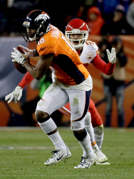 Denver Broncos wide receiver Bennie Fowler (16) pulls in a touchdown catch as Kansas City Chiefs cornerback Phillip Gaines (23) defends during the second half of an NFL football game, Sunday, Nov. 27, 2016, in Denver. (AP Photo/Jack Dempsey)