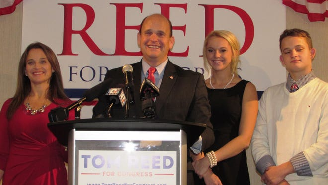 Tom Reed gives a victory speech on Tuesday at the Radisson Hotel Corning. His wife, Jean, and daughter and son, Autumn and Will, are on the podium behind him.