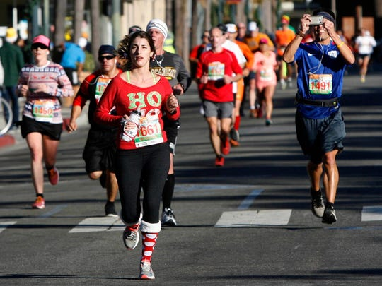 Runners make their way through downtown Oxnard in the