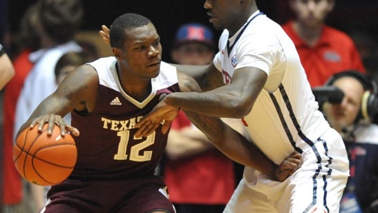 Texas A&M guard Jalen Jones (12) works against Mississippi forward M.J. Rhett during an NCAA college basketball game Wednesday, Feb. 4, 2015, in Oxford, Miss. (AP Photo/Oxford Eagle, Bruce Newman)