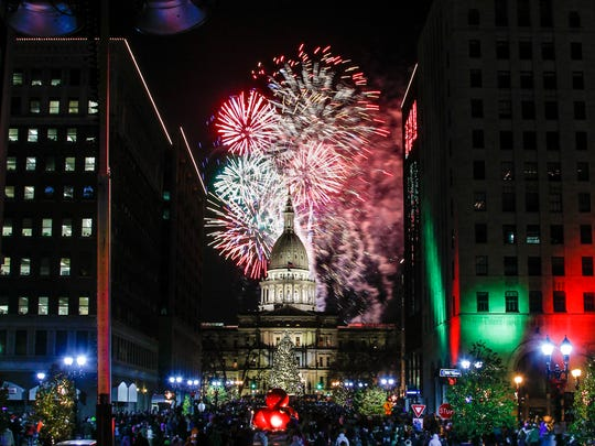 A shower of fireworks cascade down over the state Capitol