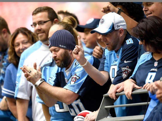 Titans fans cheer before the game against the Cardinals