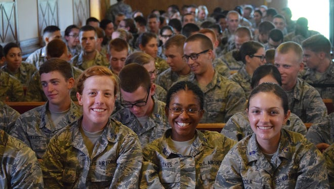 Front row, from left, Mallory Stone of Texas; Tiffany Sykes of Pennsylvania; and Carina Sicola of New Mexico attend Mass at Camp Shelby.