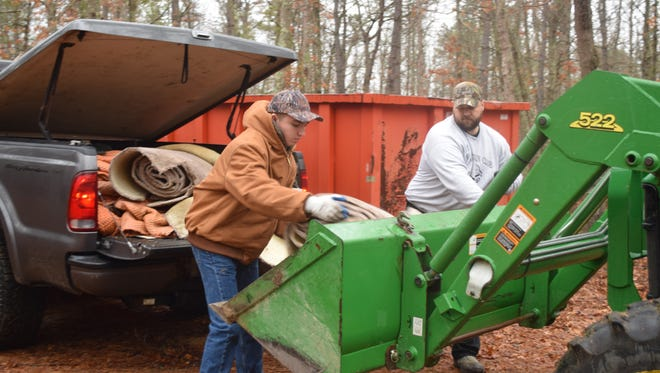 Jared Carll and Brian Makos, both of Millville, volunteered with other members of the Menantico Gun Club during the 26th Annual Cumberland County Trash Hunt. Volunteers spread out across the county to remove trash from several Wildlife Management Areas.
