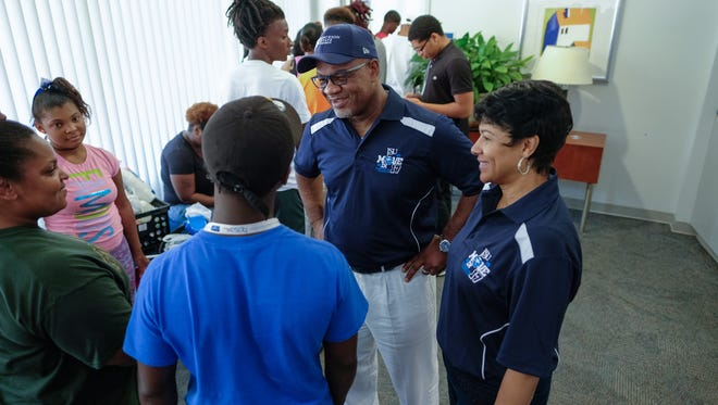 Jackson State University President William Bynum, center, and his wife, Deborah, right, were a constant presence during freshmen and transfer students' move-in day.