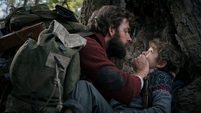 """A dad and his son (John Krasinski, Noah Jupe) must be silent to be safe in """"A Quiet Place."""""""