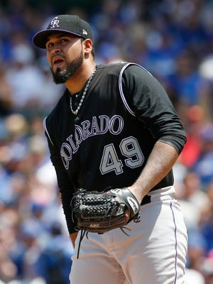 Colorado Rockies starting pitcher Antonio Senzatela reacts after Chicago Cubs' Anthony Rizzo hit an RBI double during the first inning of a baseball game Sunday, June 11, 2017, in Chicago. (AP Photo/Nam Y. Huh)