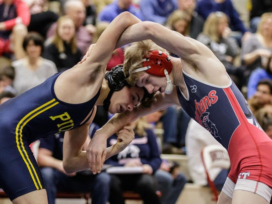 Brookfield East wrestler Hunter Fischer (right) grapples