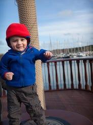 Walker Hughey enjoys the moment at Kinsale Harbor in