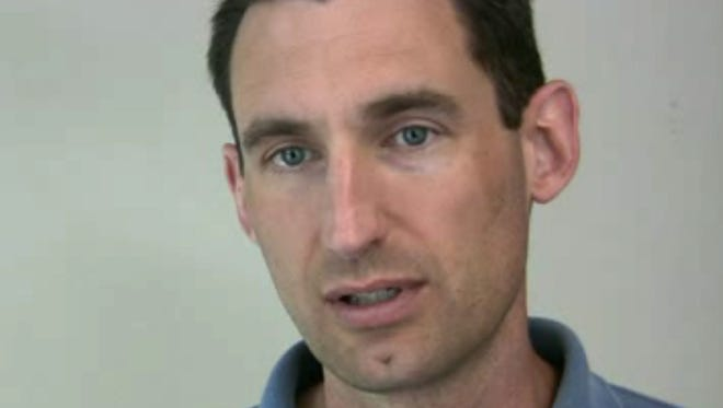 In this image from video, date not known, Mark Kruger. a Portland police officer speaks in Portland, Ore. Once-forgotten plaques placed by Kruger in a city park to honor five Nazi-era German soldiers have come back to haunt the city. The officer, Capt. Mark Kruger, threatened to sue the city last year over texts sent by a top police official to an officer characterizing him as a Nazi sympathizer. Instead of going to court, the city settled, agreeing to give Kruger 80 hours of vacation and $5,000. (AP Photo/The Oregonian, Michael Lloyd)