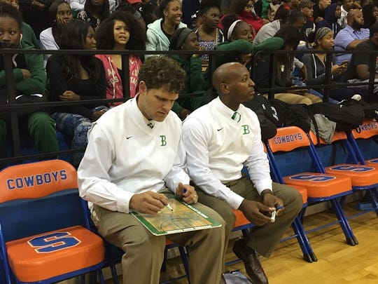 Bossier coach Nick Bohanan goes over a play prior to