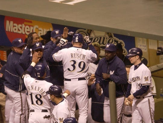 Brewers pitcher Glendon Rusch is greeted by teammates