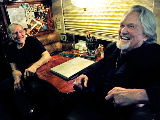 Willie Nelson, left, and Kris Kristofferson joke together while talking to the media on their bus after performing at the Bluebird Cafe on Jan. 27, 2013.