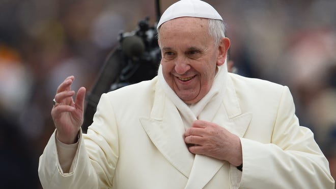 Pope Francis greets the crowd at St Peter's Square on Nov. 27.