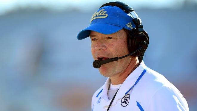 UCLA Bruins head coach Jim Mora on the sidelines during the fourth quarter against the Virginia Tech Hokies in the 2013 Sun Bowl at Sun Bowl Stadium.