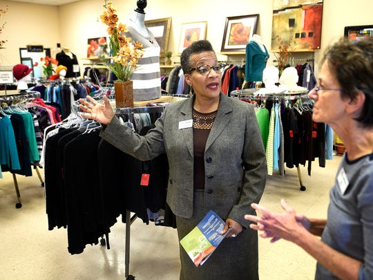 GraceWorks' CEO/President Valencia Breckenridge talks with Diana Lucas inside the thrift store Wednesday Nov. 16, 2016, in Franklin, Tenn. Breckenridge comes to GraceWorks from the Chicago area, where she served 25 years in nonprofit fundraising and management.