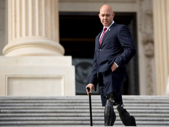 U.S. Rep. Brian Mast, R-Palm City, is an Army veteran who lost his legs while serving in Afghanistan.