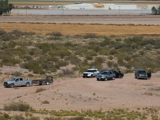 FAA, Hatch Police and New Mexico State Police on Monday, Nov. 6, 2017, investigate the site of a fixed-wing single engine Cessna crash near the Hatch Airport. New Mexico State Police found the wreckage around 5:30 p.m. Sunday. Four people died in the crash.
