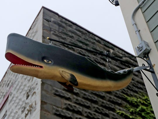 The whale that hangs outside Lost Whale bar on KK in