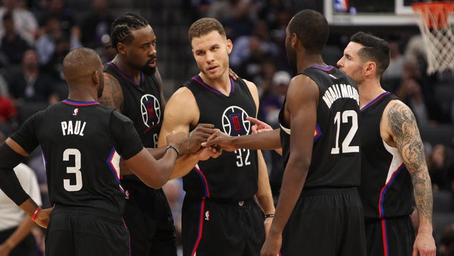 Blake Griffin huddles with  guard Chris Paul, center DeAndre Jordan, forward Luc Mbah a Moute and guard J.J. Redick during the second half against the Sacramento Kings at Golden 1 Center.