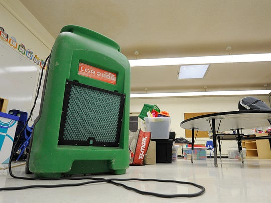 A dehumidifier is seen inside a classroom at Whitehall
