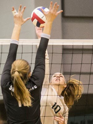 York Catholic's Abigail Pilkey (10), goes up for the spike against Trinity's Noelle Chavey (16), during the first set of a District 2-A volleyball semi-final match Thursday, Nov. 3, 2016 at Dallastown Area High School. York Catholic won 3-1. Amanda J. Cain photo