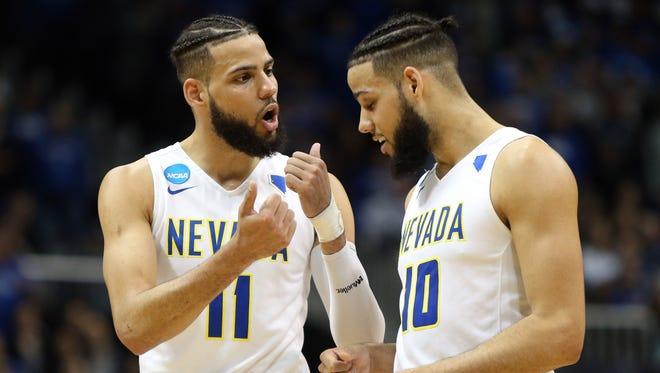 Nevada's Cody Martin (11) talks with brother Caleb Martin during the NCAA Tournament last season.